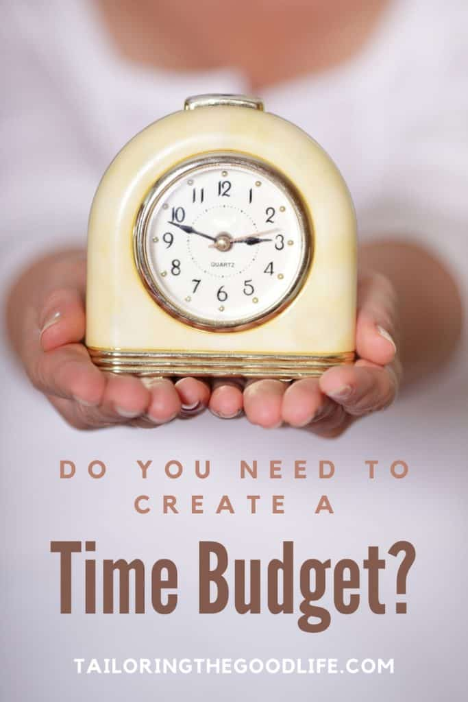 lady holding an old fashioned alarm clock - Do you need to create a time budget?