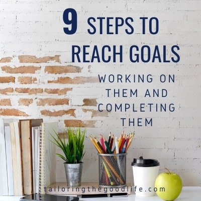 Workspace with office accessories, a mobile phone, a cup of coffee and an apple - 9 Steps to Reach Goals