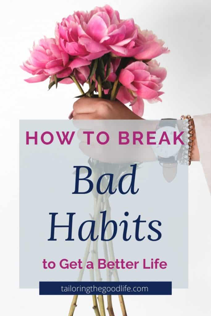 how to break bad habits - woman's hand holding flowers