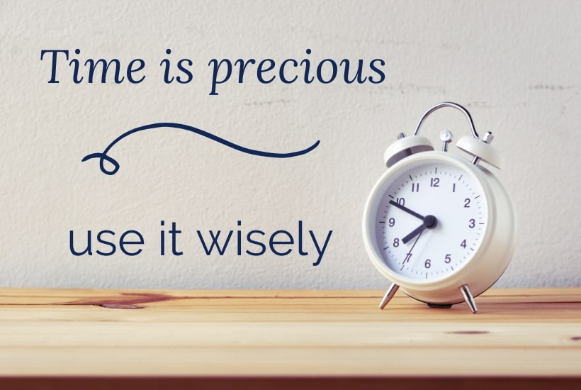 a white alarm clock on a pinewood table - time is precious, use it wisely - do you need to create a time budget