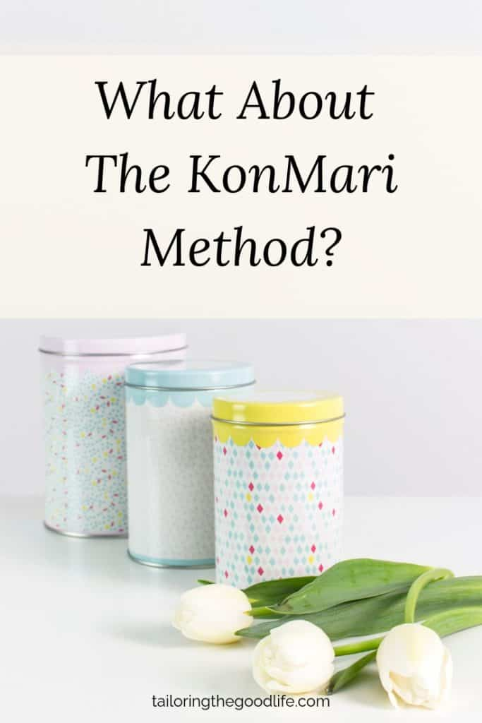 3 tin cans and white tulips on a white desk - what about the KonMari Method?